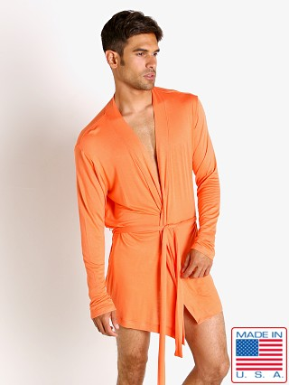 Model in tangerine Go Softwear Body 2 Extreme Robe