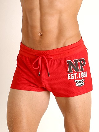 Model in red Nasty Pig Hustle Trunk Short