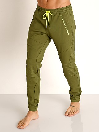 Model in green Nasty Pig Excursion Pant