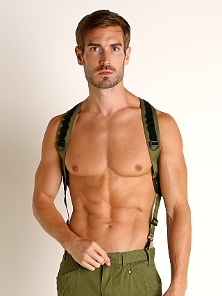 Model in green Nasty Pig Tracker Suspender Harness