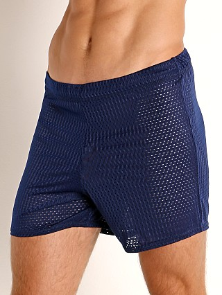 Model in navy McKillop Push Expose Mesh Fitness Shorts