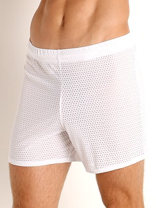 Model in white McKillop Push Expose Mesh Fitness Shorts