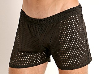 Model in black McKillop Shadow Glory Mesh Shorts