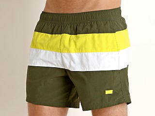 Model in olive/lime Hugo Boss Filefish Swim Shorts