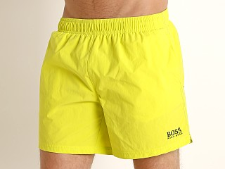 Model in neon yellow Hugo Boss Perch Swim Shorts