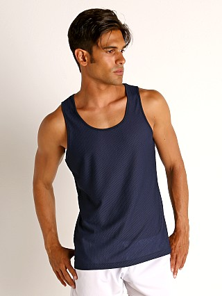 Model in navy St33le Honeycomb Mesh Performance Tank Top