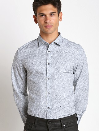 Model in white Diesel S-Palong Allover Print Shirt
