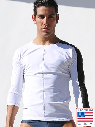 Model in white Rufskin Deep 3/4 Sleeve Rubber Panel Rash Guard