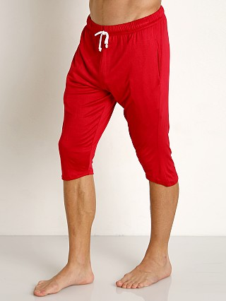 Model in red McKillop Modal Sliders Sports and Lounge Shorts