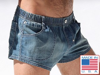 Model in sun kissed blue Rufskin Tiber Stretch Denim Shorts
