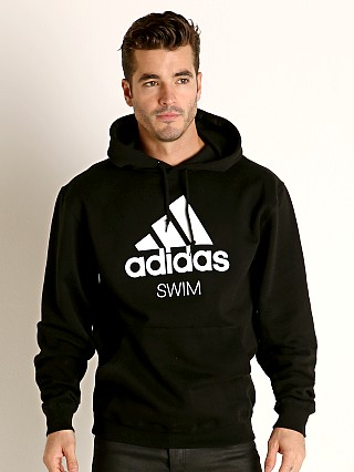 Model in black Adidas Swim 10 Oz Fleece Hoodie
