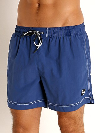 Model in blue Hugo Boss Tuna Swim Shorts