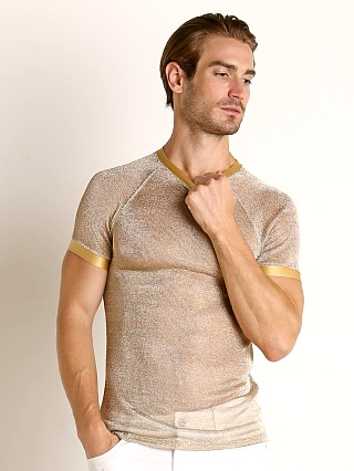 Model in gold Modus Vivendi Armour Line Mesh T-Shirt