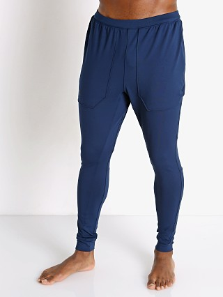 Model in academy blue Under Armour Rush Fitted Pant