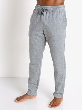 Model in gray light heather Under Armour Rival Fleece Pants