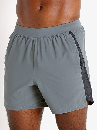 "Model in pitch gray Under Armour Launch 5"" Running Short"