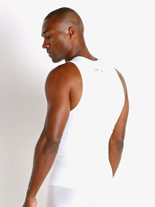 Model in white Under Armour HeatGear Compression Muscle Tee