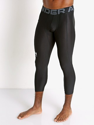 Model in black Under Armour Heatgear 3/4 Compression Legging