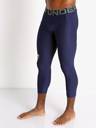 Model in midnight navy Under Armour Heatgear 3/4 Compression Legging