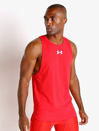 Model in red Under Armour Baseline Cotton Tank Top