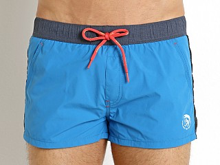 Model in mediterranean blue Diesel Caybay Swim Shorts