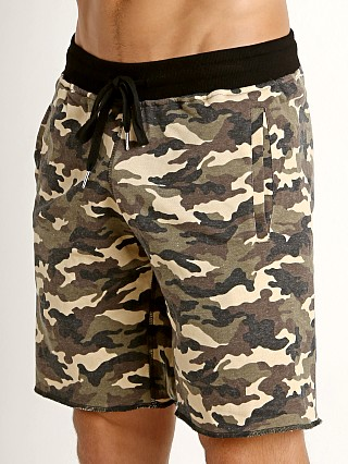 Model in green camo St33le Vintage Wash Fleece Raw Edge Shorts