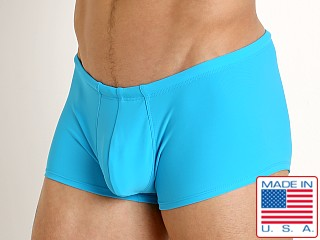 Model in turquoise Rick Majors Low Rise Swim Trunk