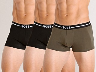 Model in black/olive/black Hugo Boss Trunks 3-Pack