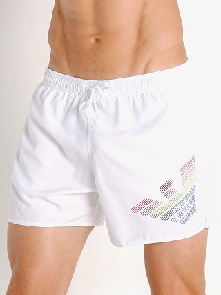 Model in white Emporio Armani Rainbow Eagle Swim Shorts