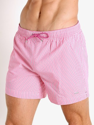 Model in pink Hugo Boss Velvetfish Swim Shorts