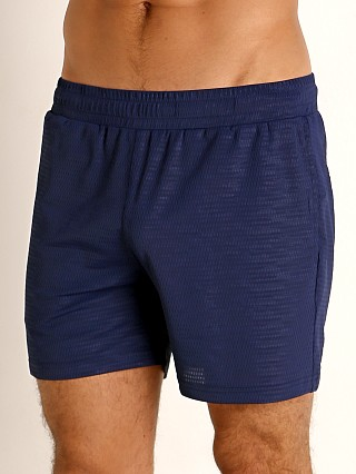 Model in atlantic blue St33le Embossed Mesh Performance Shorts