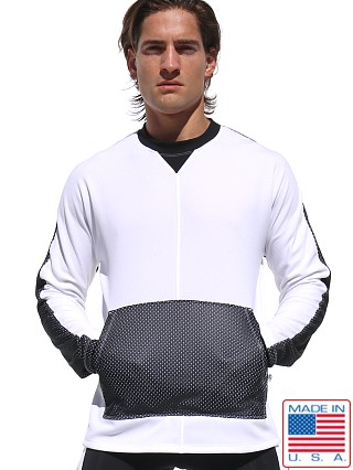 Model in white Rufskin Ray Longsleeve Mesh Sport Top