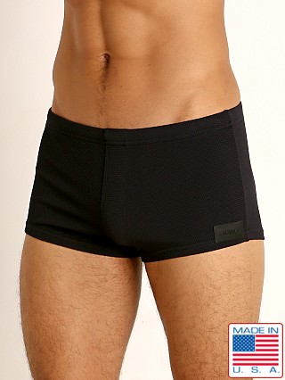 Model in black Sauvage Pique Textured Square Cut Swim Trunk
