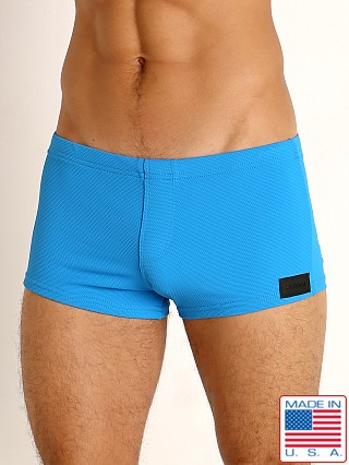 Model in royal Sauvage Pique Textured Square Cut Swim Trunk