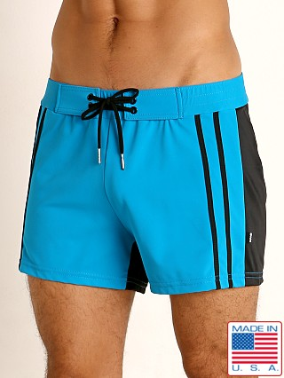 Model in teal/black Sauvage Moderno Two-Tone Swim Short
