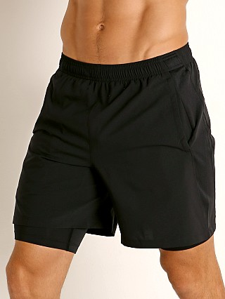 Model in black-black-reflective Under Armour Launch SW 2-in-1 Men's Running Shorts Black
