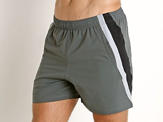 "Model in pitch gray/reflective Under Armour Launch 5"" Running Short"