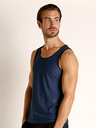 Model in navy St33le Air Mesh Performance Tank