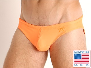 Model in neon orange LASC St. Tropez Low Rise Swim Brief