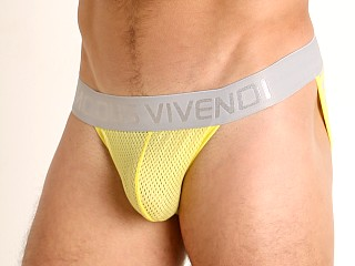 Model in yellow Modus Vivendi Pop Perforated Mesh Tanga Sports Brief