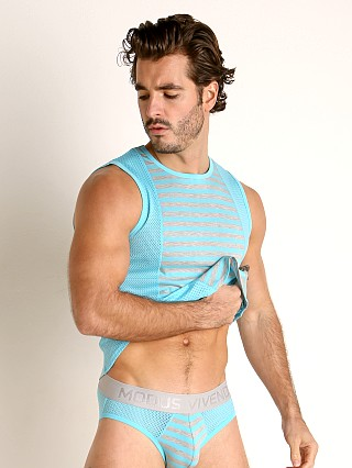 Model in aqua Modus Vivendi Pop Perforated Mesh Muscle Shirt