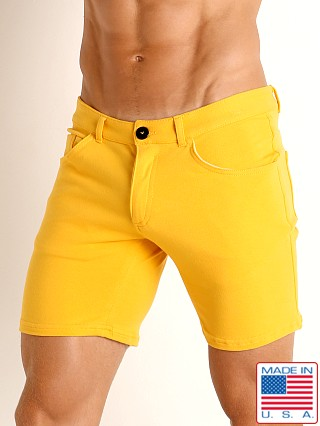Model in sunset gold Go Softwear Havana 5-Pocket Short
