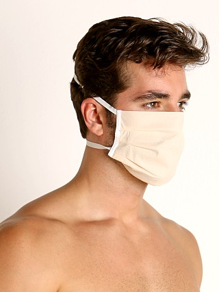 Model in cream McKillop Polypropylene Face Mask