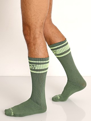 Model in beetle green Nasty Pig Hook'd Up Sport Socks
