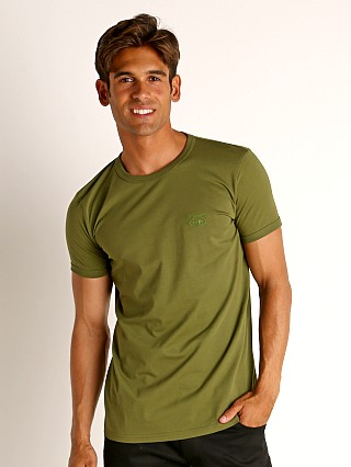 Model in green Nasty Pig Brandmark T-Shirt