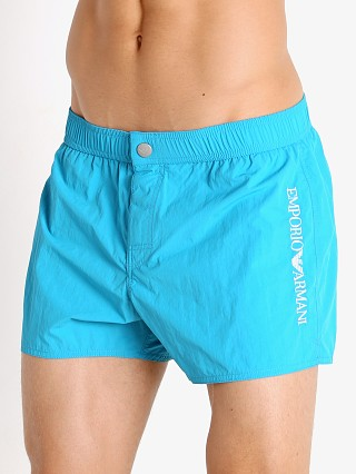 Model in ocean Emporio Armani Embroidery Logo Swim Shorts