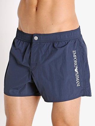 Model in navy blue Emporio Armani Embroidery Logo Swim Shorts