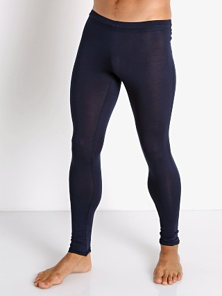 Model in navy McKillop Sleek Modal Tights