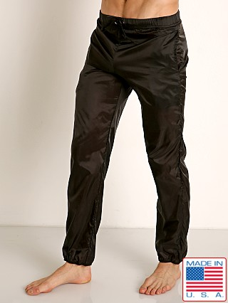 Model in black Go Softwear Hard Core Fluid Warm-up Pants