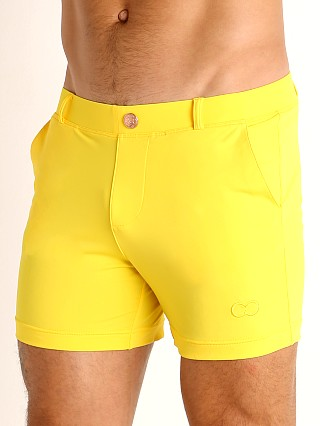 Model in gold 2EROS Bondi Swim Shorts